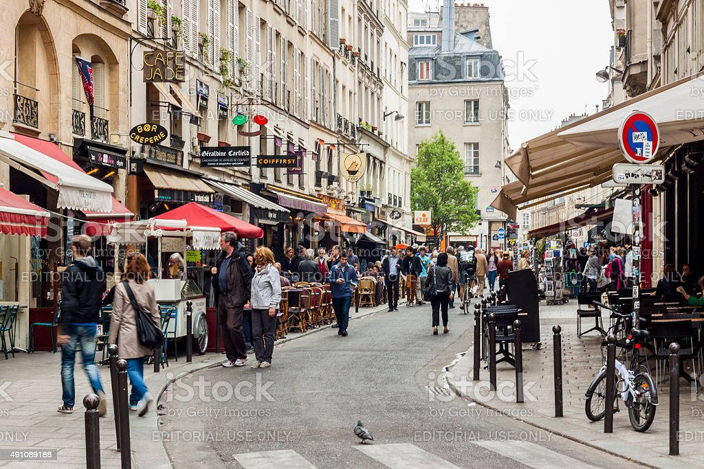 Tourists walk past a cafeteria and souvenir store - Paris. stock photo