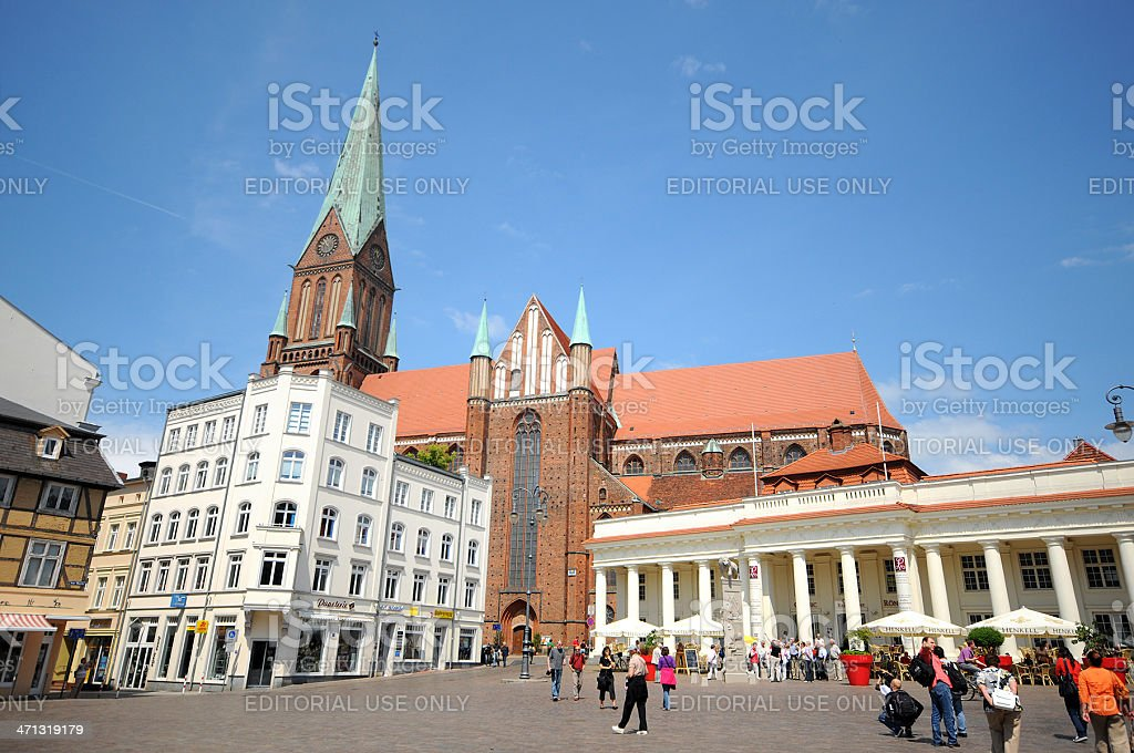 Tourists walking across the market place at schwerin city stock photo