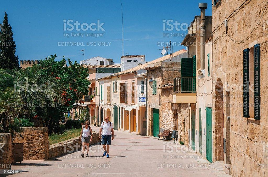 Tourists walking along in Alcudia, Mallorca стоковое фото