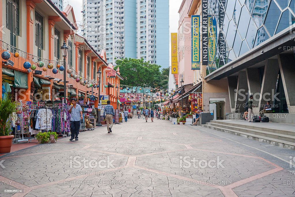 Tourists walking along little India district in Singapore stock photo