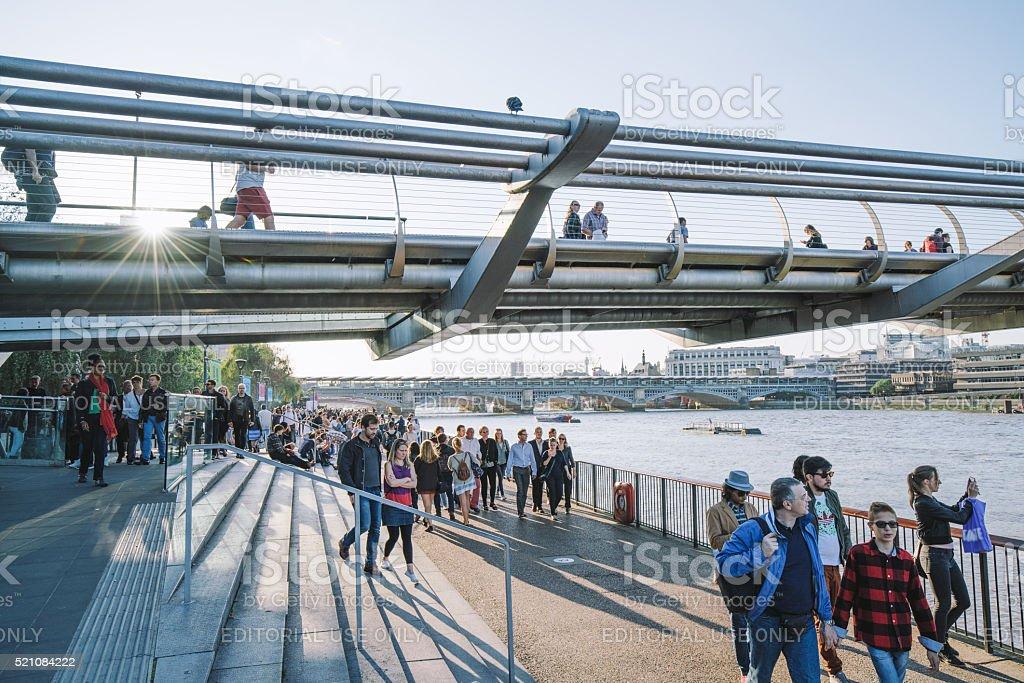 Tourists walking along the Millenium Bridge in London, UK stock photo