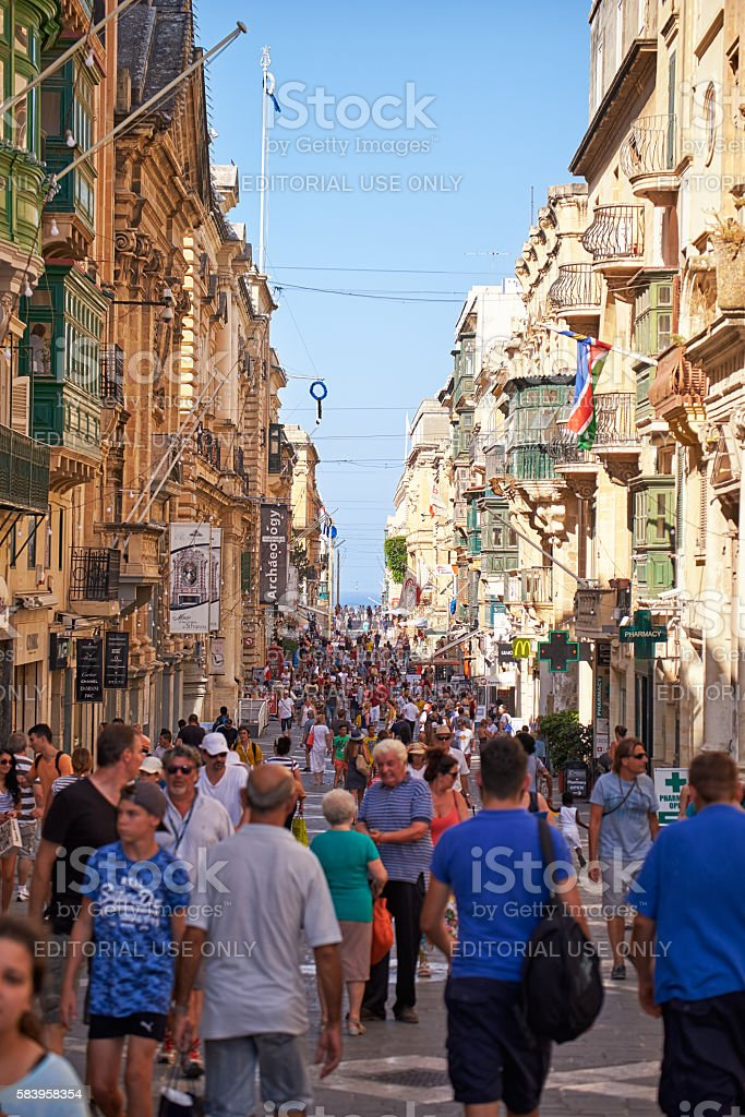 A tourists walking along the Republic street of Valletta, Malta stock photo