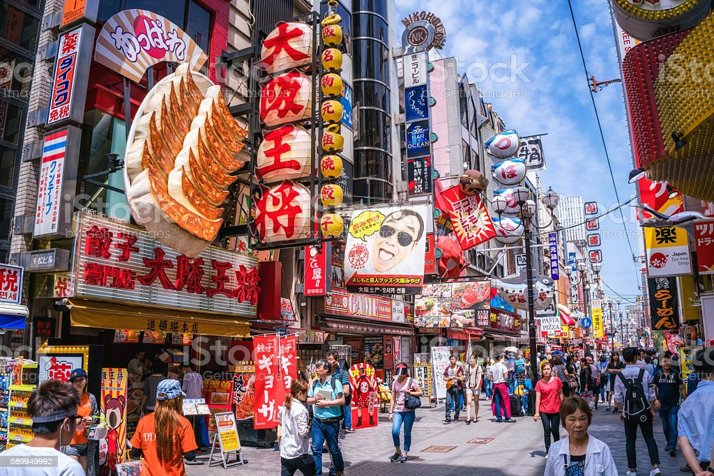 Tourists walking around crowded Osaka Dotonbori entertainment district stock photo