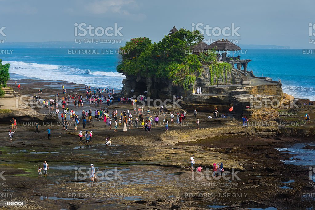 Tourists walking around Tanah Lot temple stock photo