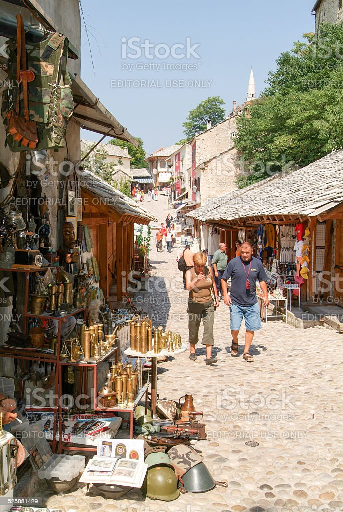 Tourists walking between the gift shops at Mostar stock photo