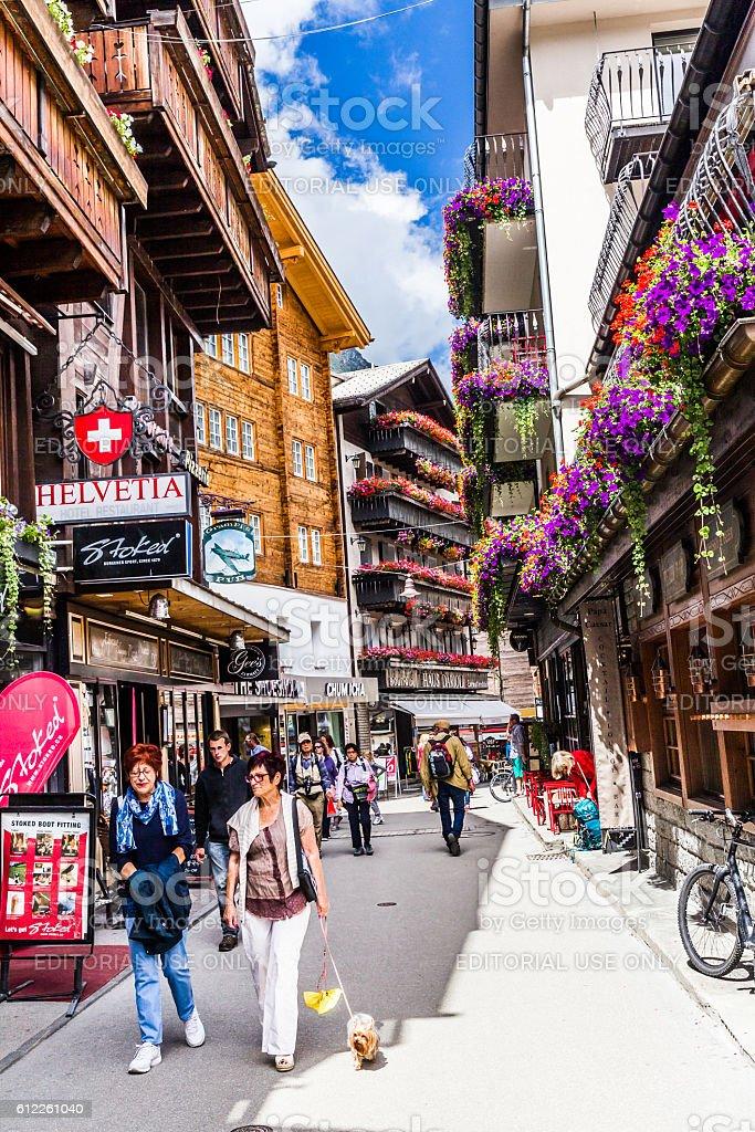 Tourists walking in Zermatt village, Switzerland stock photo
