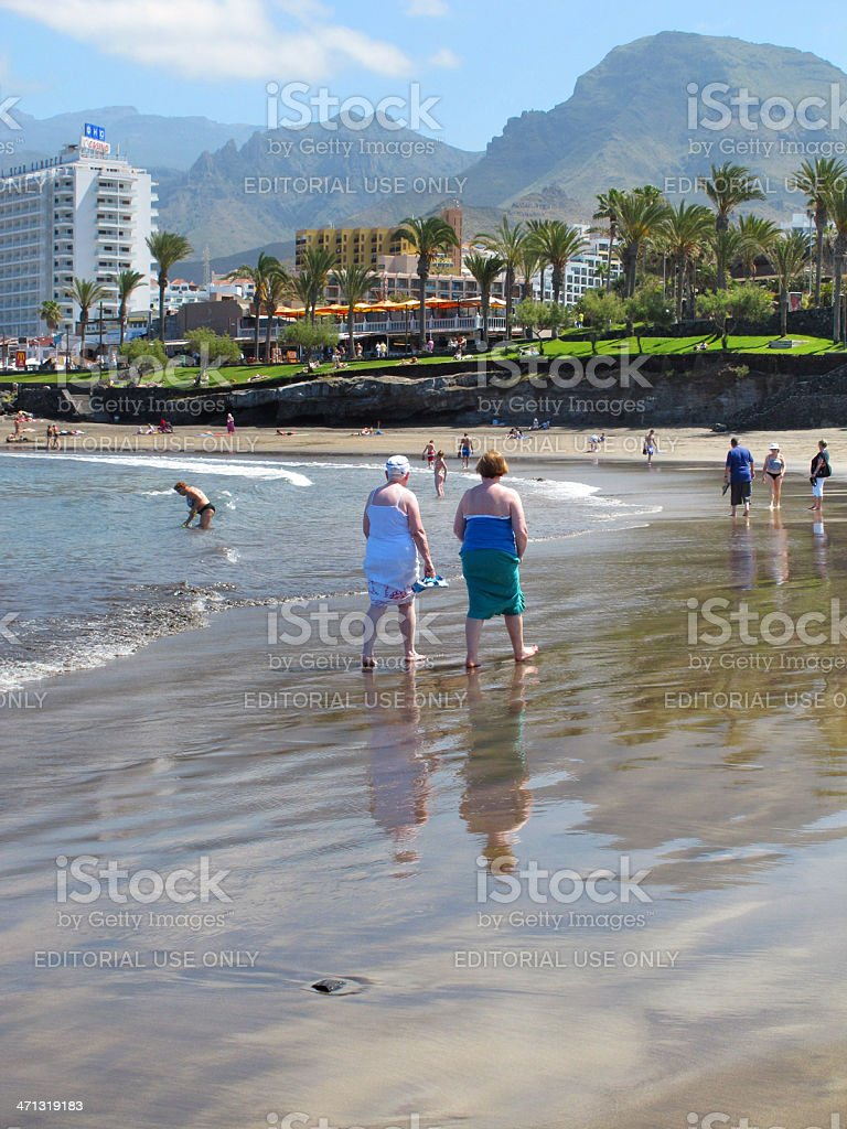 tourists walking on Beach of Playa de las Americas Tenerife stock photo