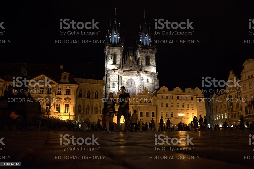 Tourists walking on Old town square at night, Prague stock photo