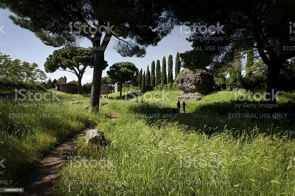 Tourists walking on the Appian way, or Via Appia Antica stock photo