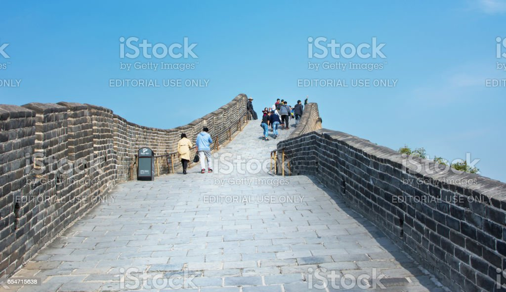 Tourists walking on the Great wall of China stock photo