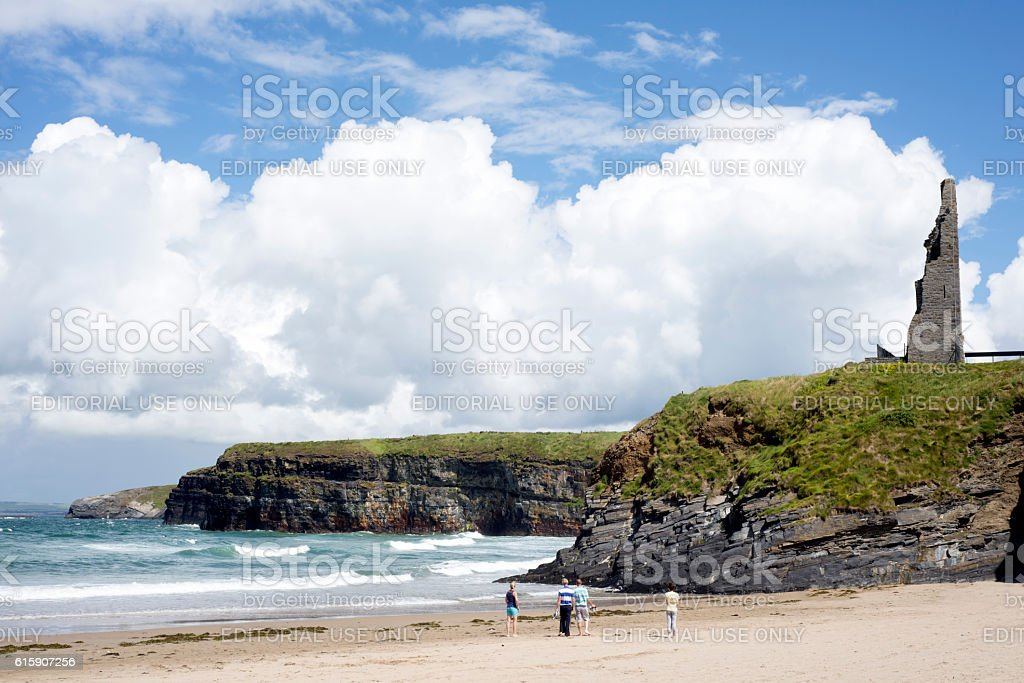 tourists walking the beach stock photo