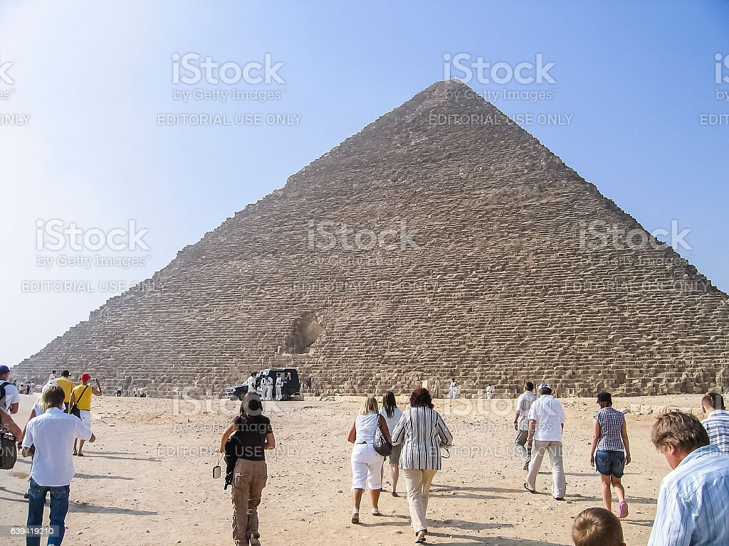 Tourists walking up to see the great pyramid stock photo