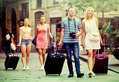 Tourists walking with suitcases