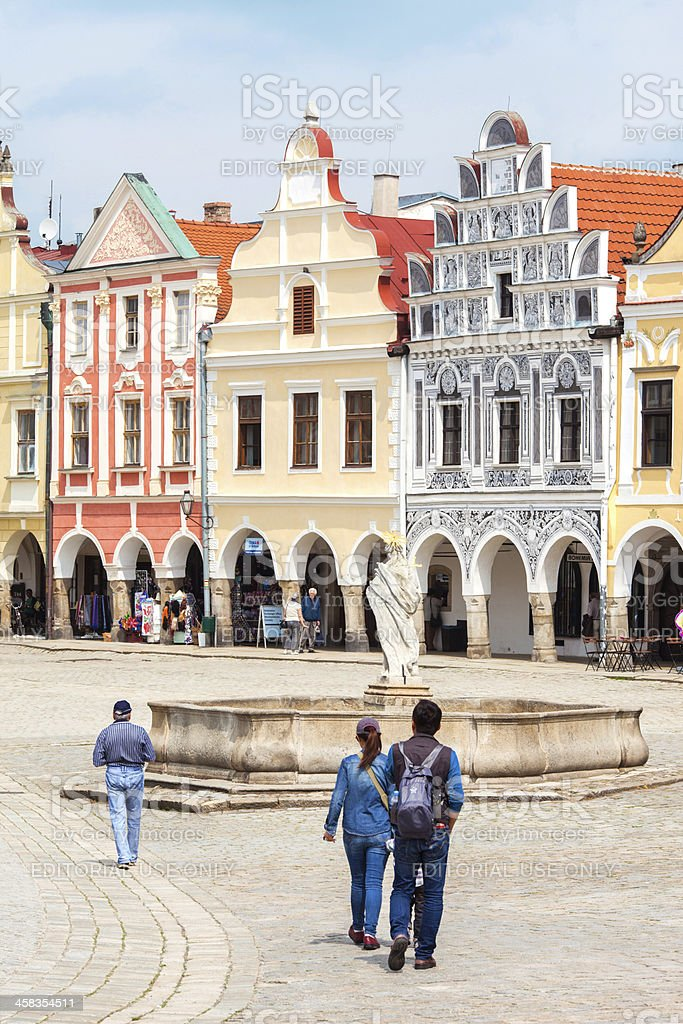 Tourists walks around main marget in Telc city, Czech Republic. royalty-free stock photo
