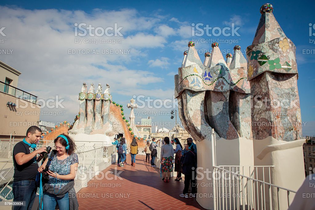 Tourists watch colorful chimneys on the roof of Casa Batllo stock photo