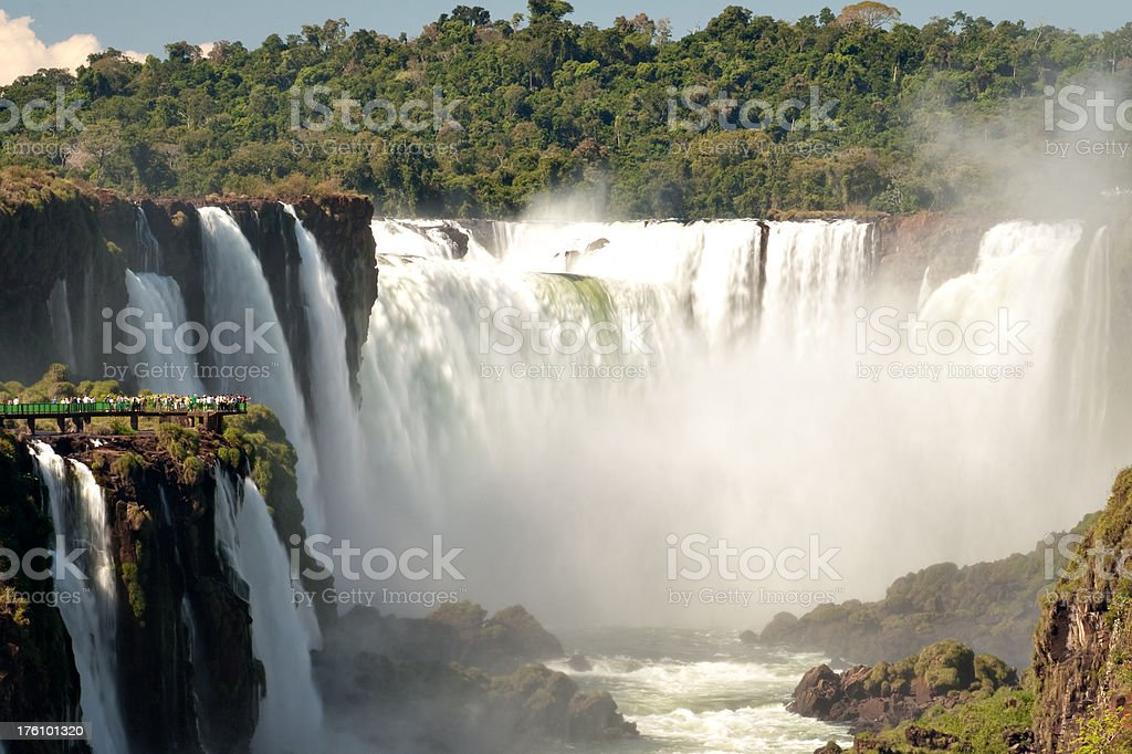 Tourists watching Iguazu Falls royalty-free stock photo