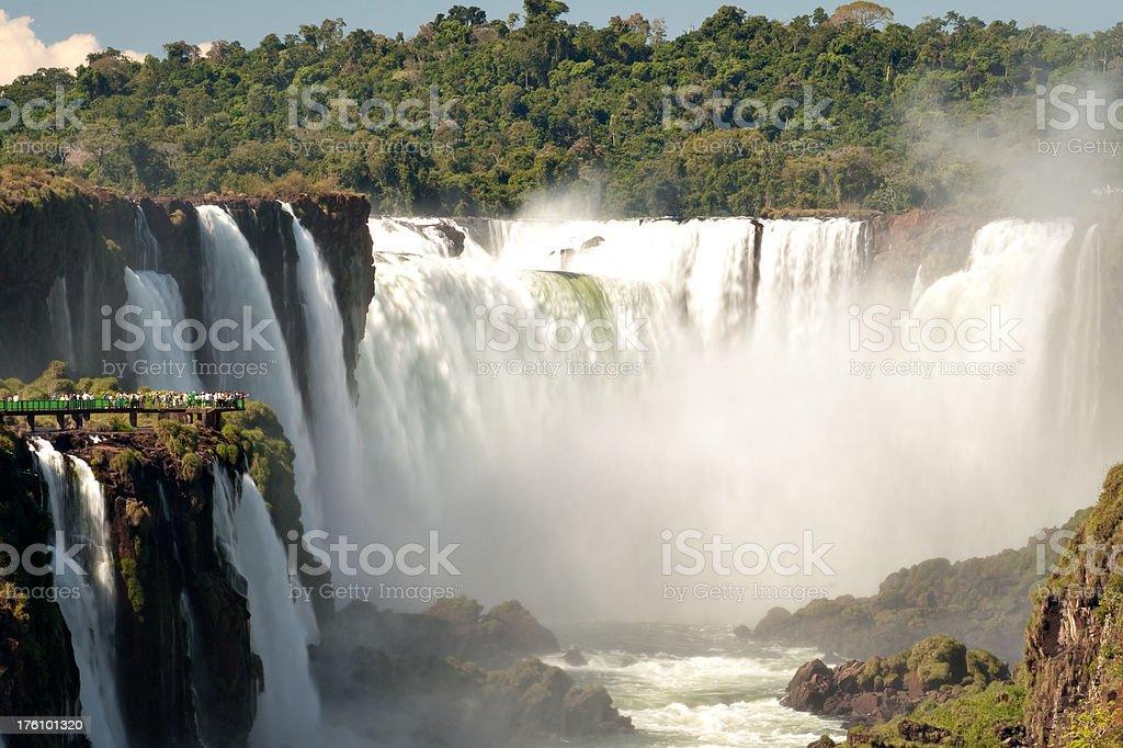 Tourists watching Iguazu Falls stock photo