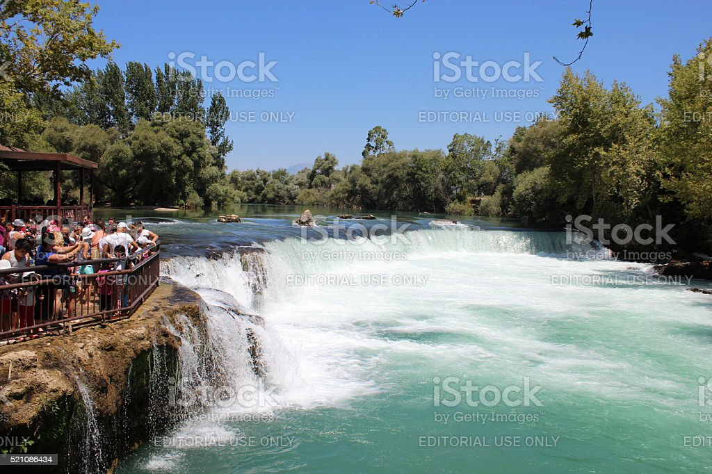 Tourists watching Manavgat waterfall stock photo
