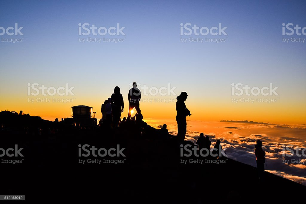 Tourists watching sunset on Haleakala Summit - Maui, Hawaii stock photo