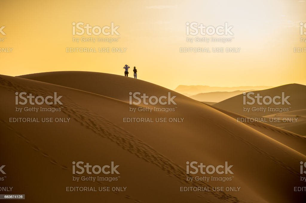 Tourists Watching The Sun Set at Erg Chebbi stock photo