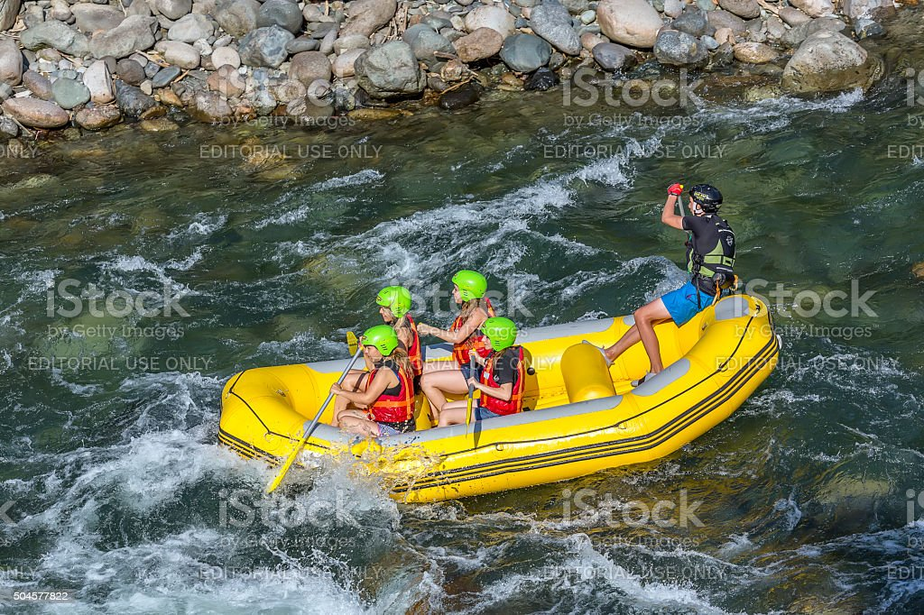 Tourists who rafting on the river storm. stock photo