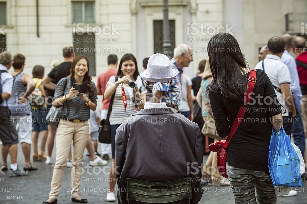 Tourists with a Street Artist: the invisible man stock photo