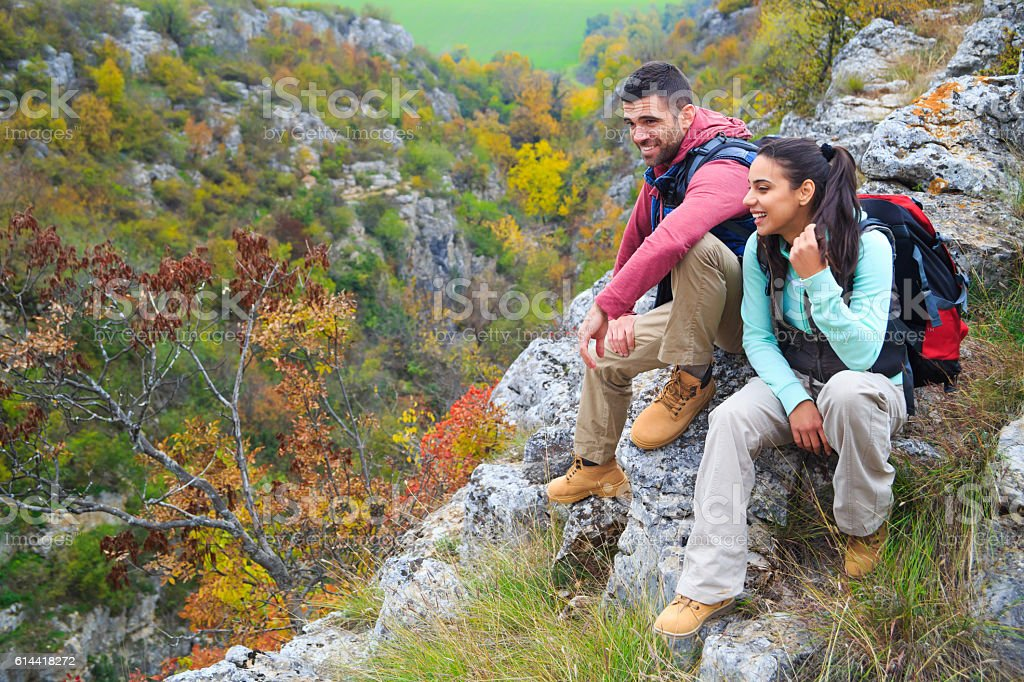 Tourists with backpacks enjoying colored nature view stock photo