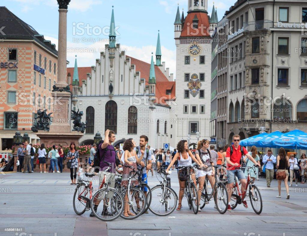 Tourists with bicycles on Marienplatz, Munich stock photo