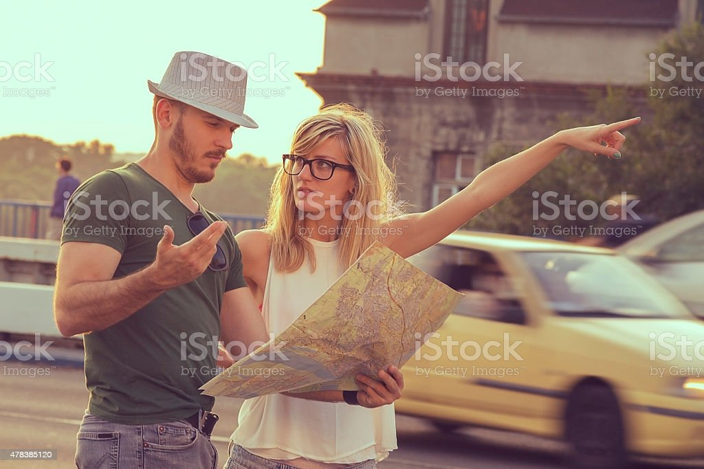 Tourists with city map stock photo