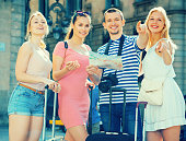 Tourists with map and suitcases