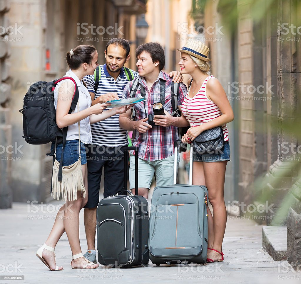 tourists with map exploring the city destination stock photo