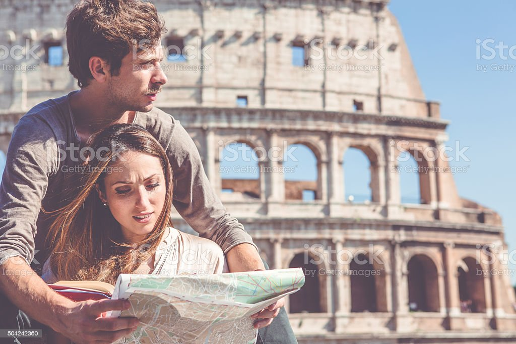 Tourists with  map in front of the Coliseum stock photo
