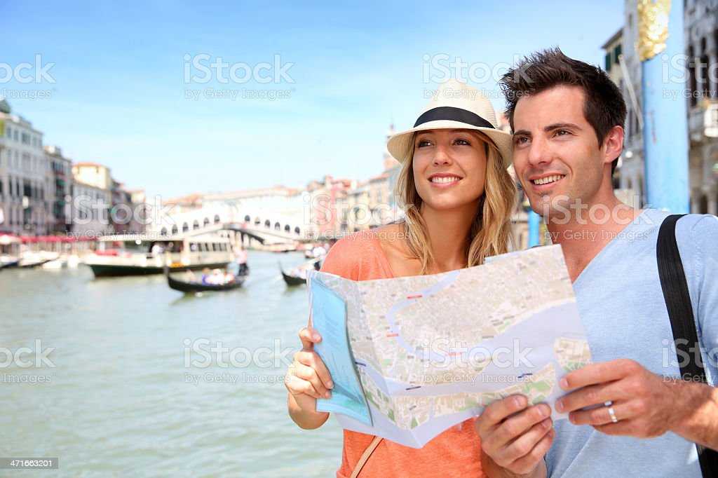 Tourists with map near canal of Venice royalty-free stock photo