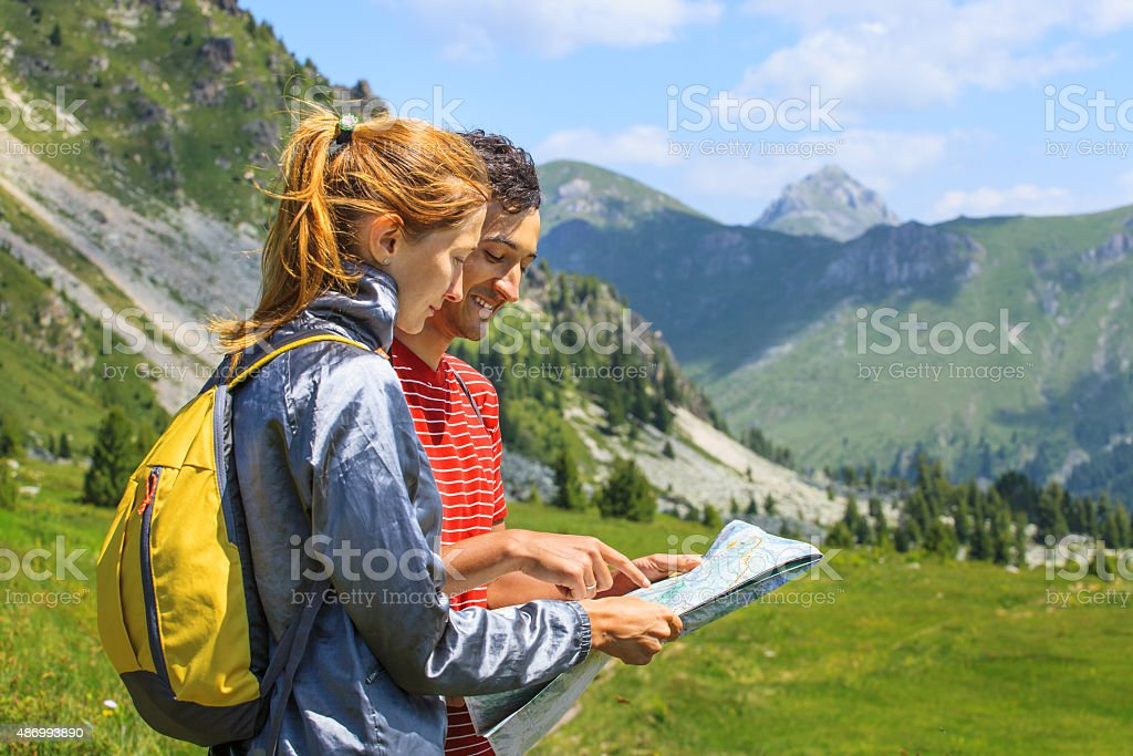 Tourists with map stock photo