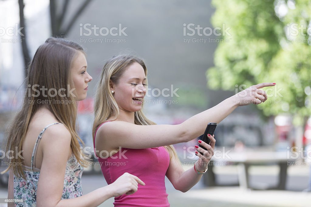 Tourists with smart phone royalty-free stock photo