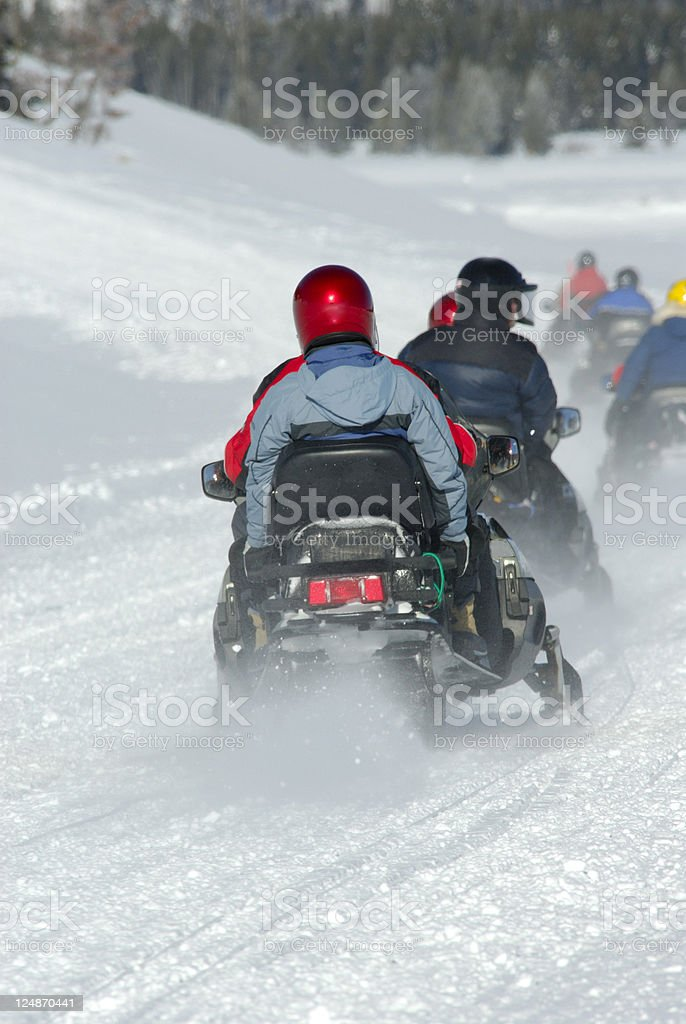 Tourning Yellowstone National Park by Snowmobile royalty-free stock photo