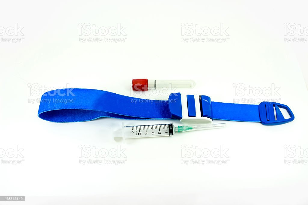 Tourniquet, blood tube, syringe and needle. stock photo