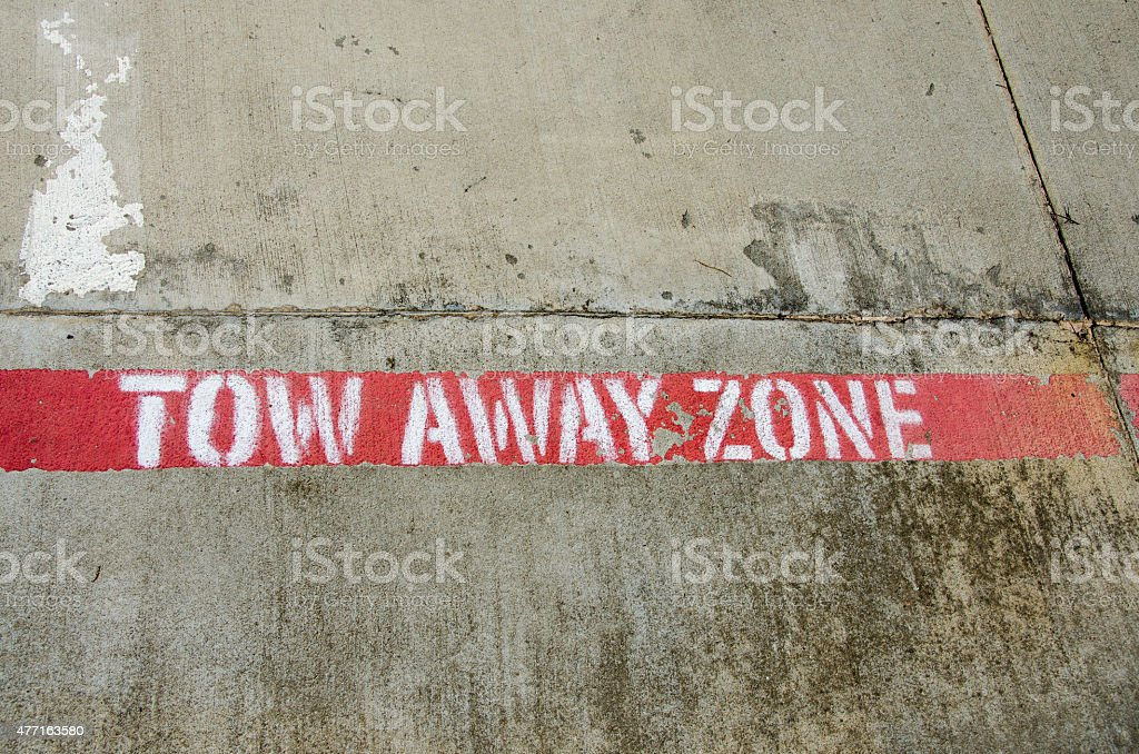 Tow Away Zone Warning Painted on Pavement stock photo