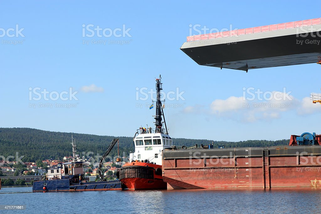 tow boat working with a bridge royalty-free stock photo