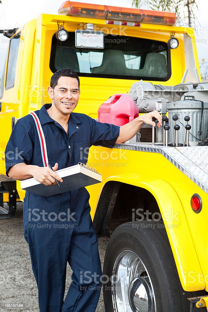 Tow truck driver ready to serve stock photo