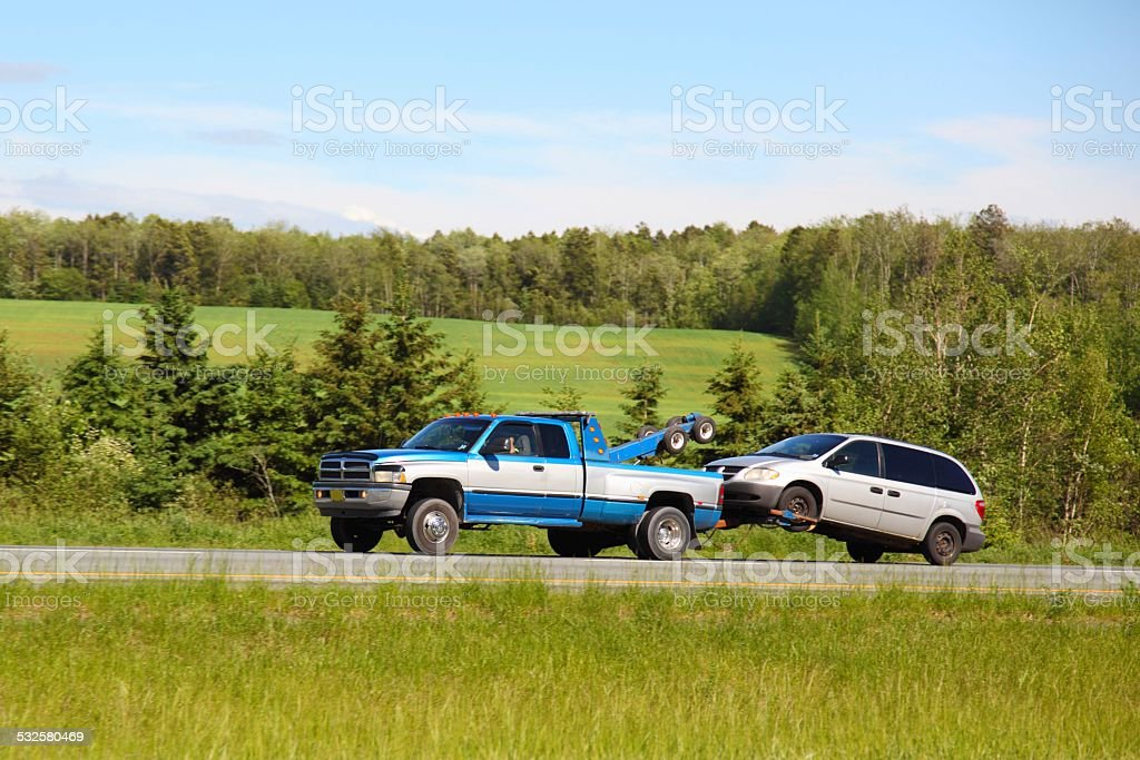 Tow truck towing another truck stock photo