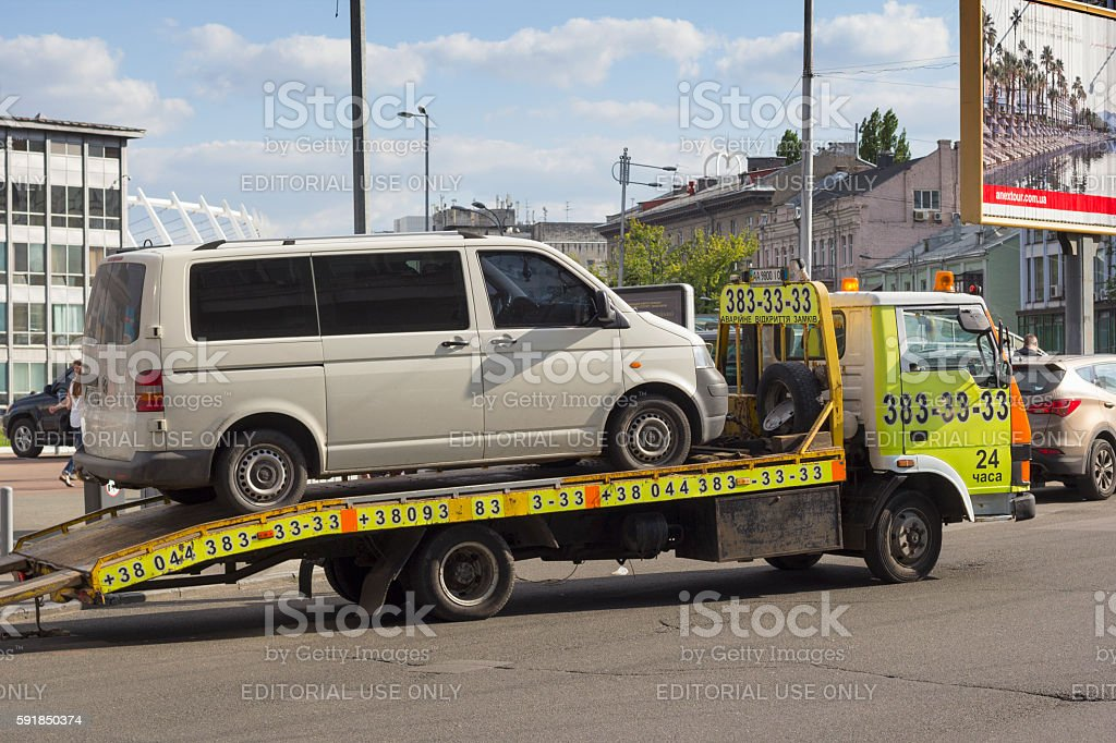 Tow truck with a car on stock photo
