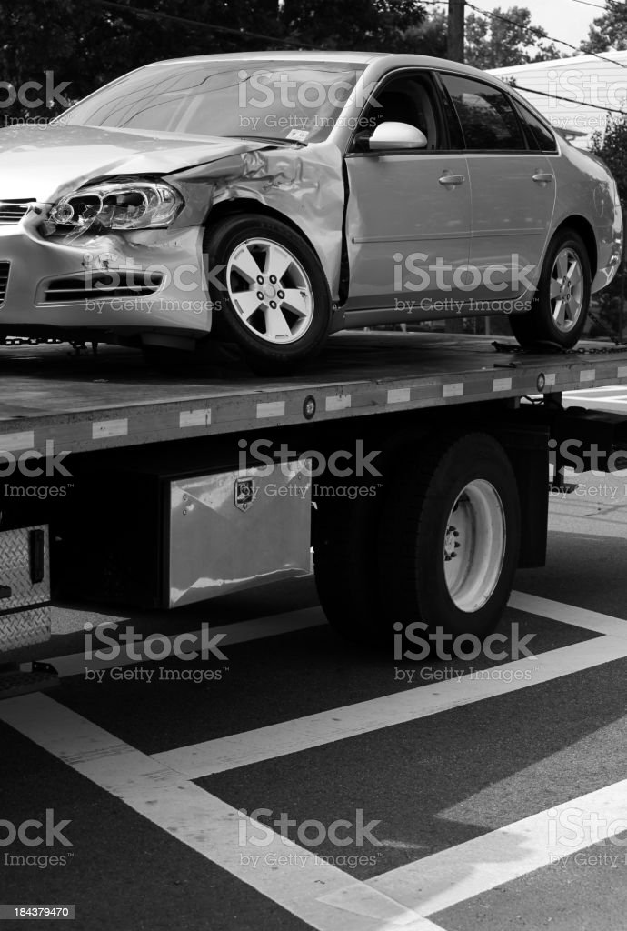 Tow Truck with Damaged Car stock photo