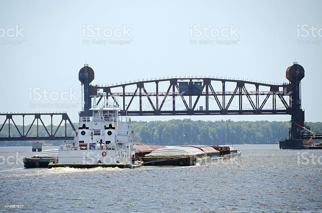 towboat and barges passing under Burlington Rail Bridge, Burlington, Iowa stock photo