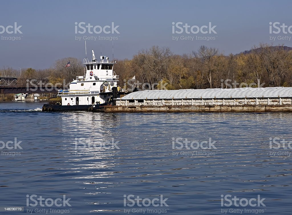 Towboat pushing a barge on the river stock photo