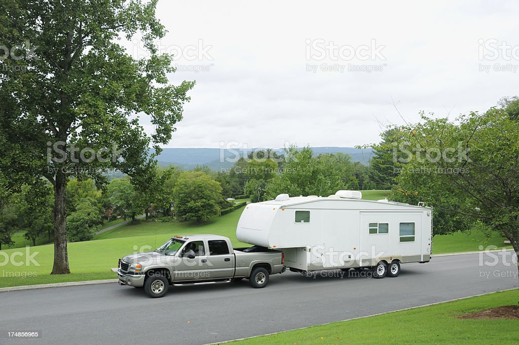 Towed recreational vehicle in mountains royalty-free stock photo