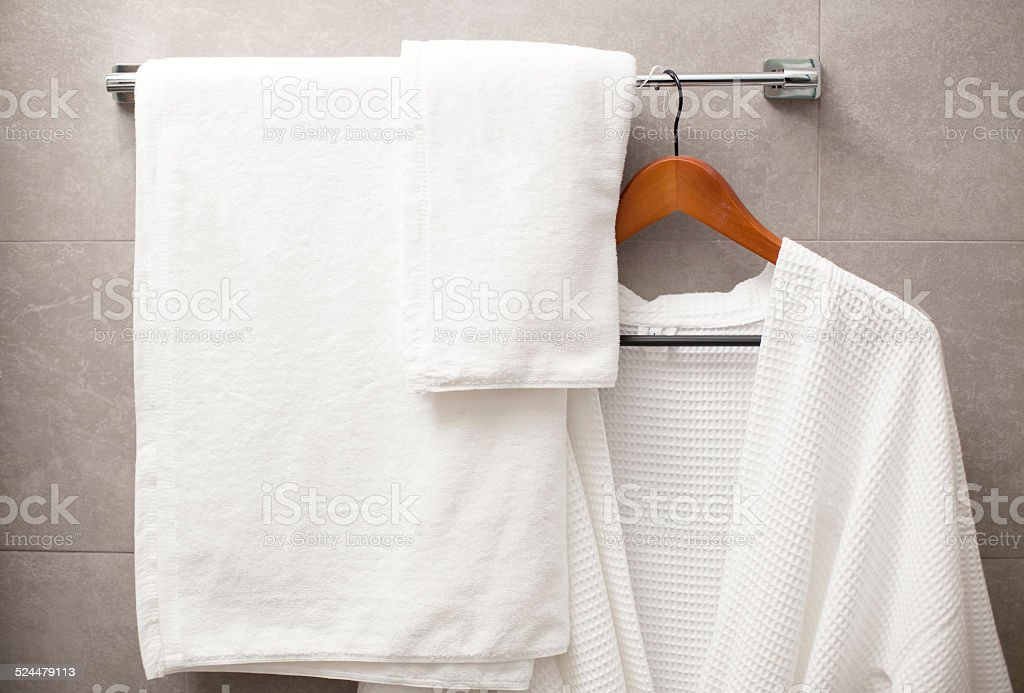 towel and robe on the rack in the bathroom stock photo