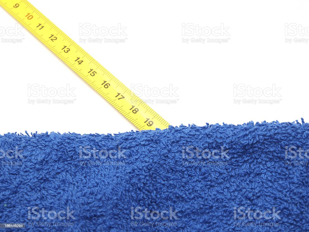 Towel and ruler royalty-free stock photo
