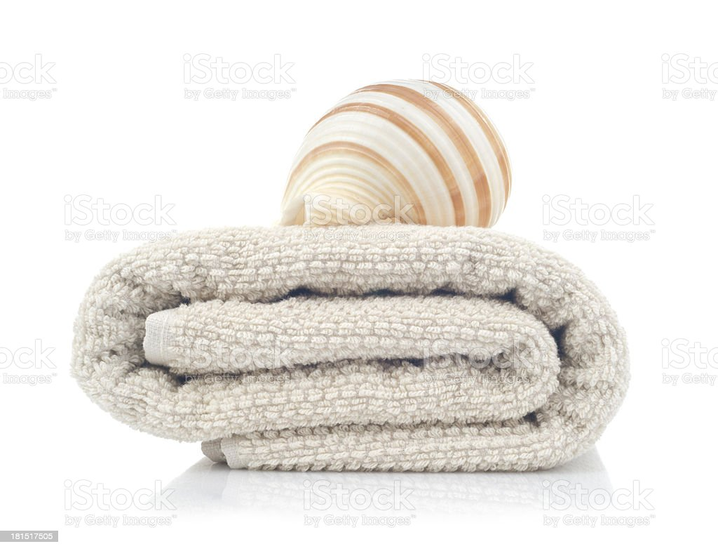 Towel and seashell isolated on white royalty-free stock photo