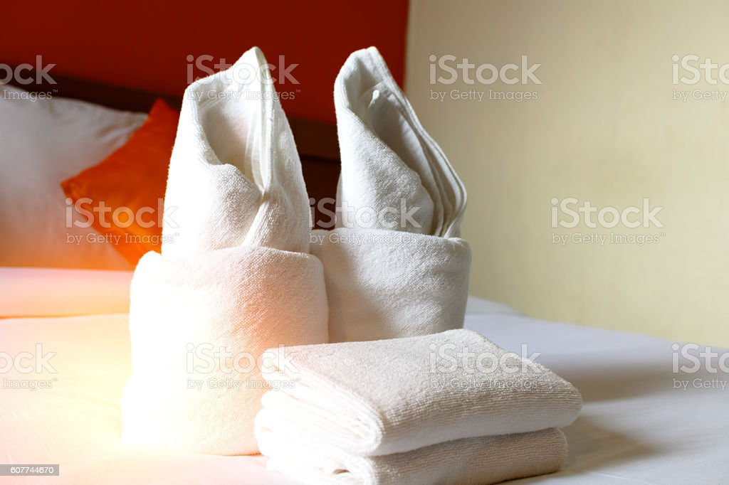 towel in Bedroom - home room or hotel room interiors. stock photo